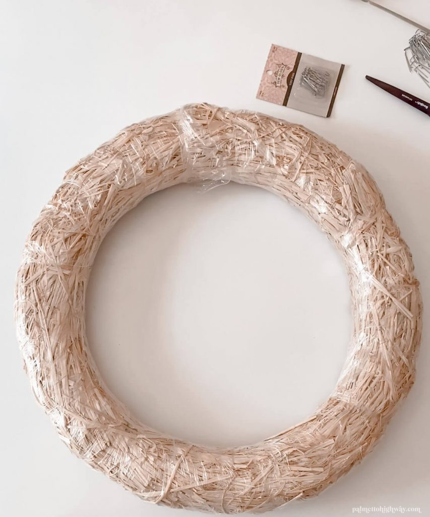 A straw wreath set on a table