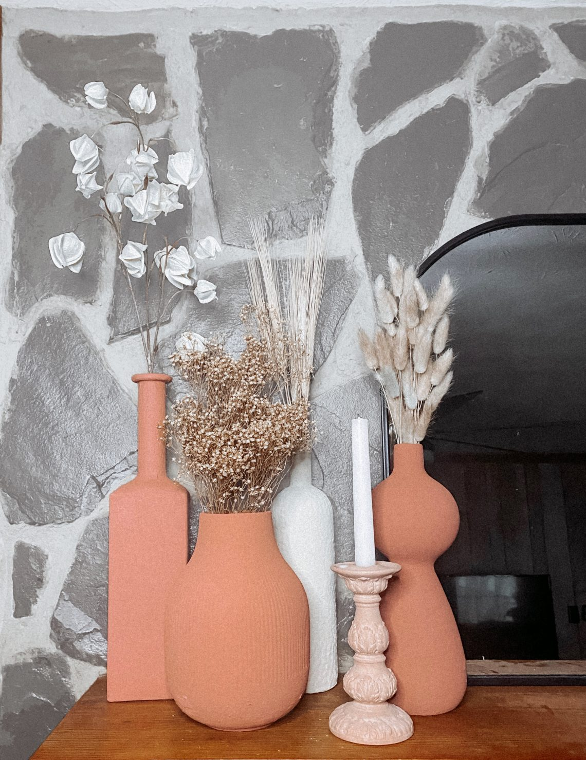 Terracotta and Cream vases on a mantle with dried plants