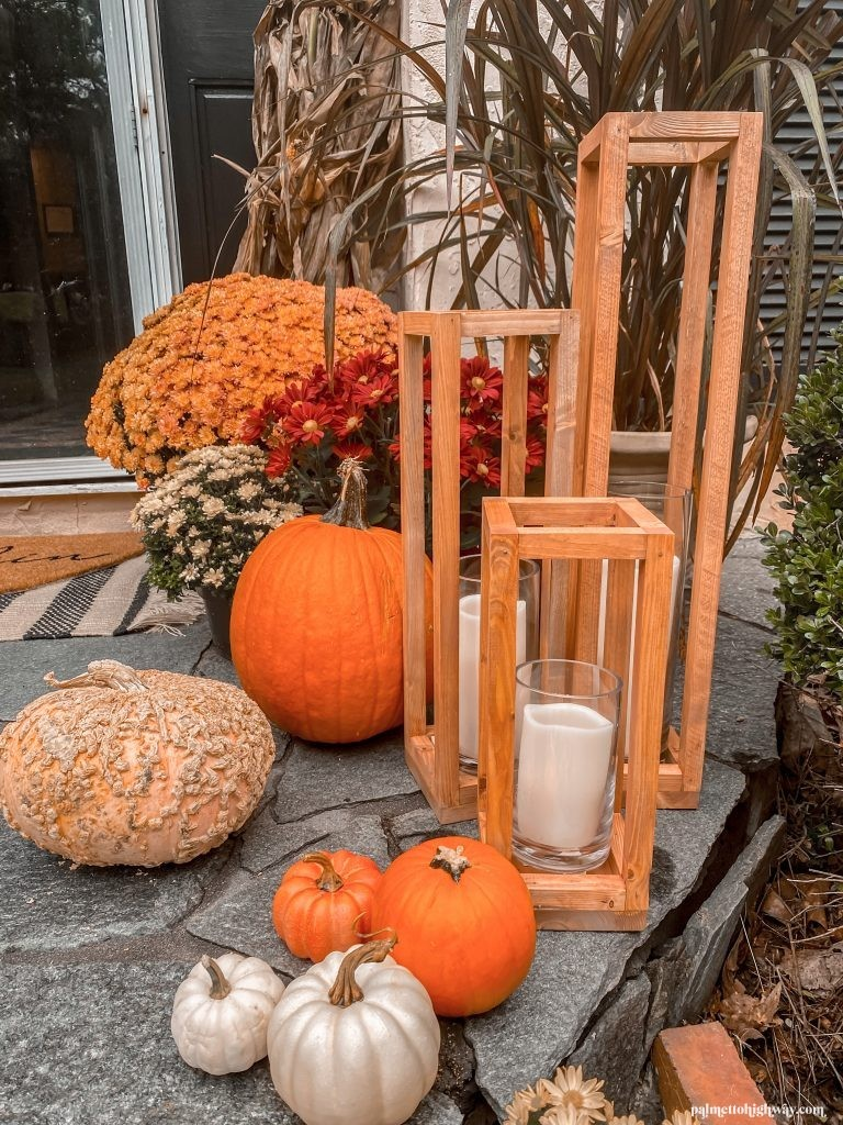 My scrap wood lanterns surrounded by pumpkins and mums