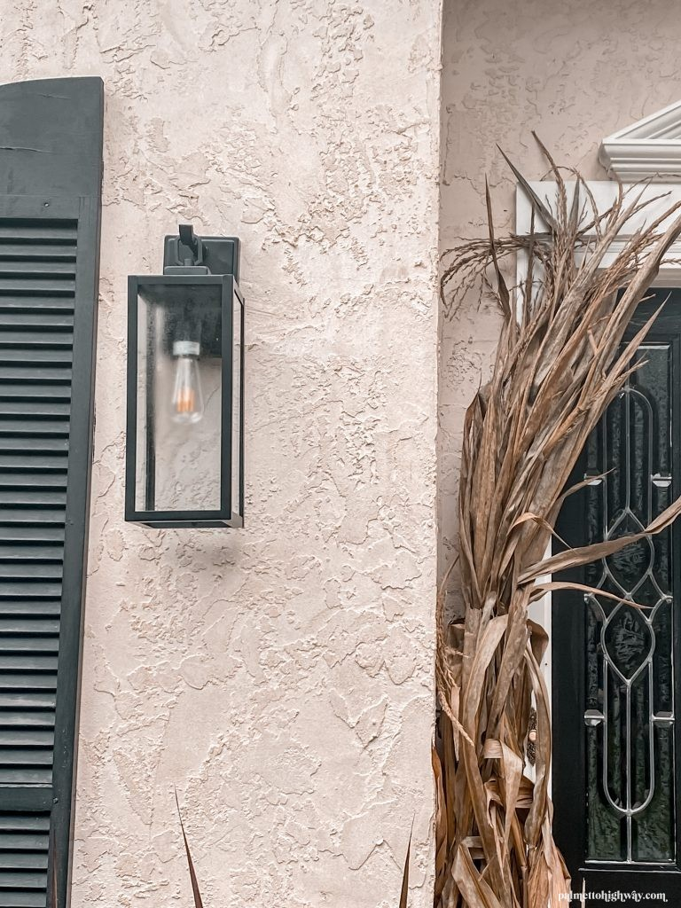 This is a closeup that shows the modern black sconce/lanterns