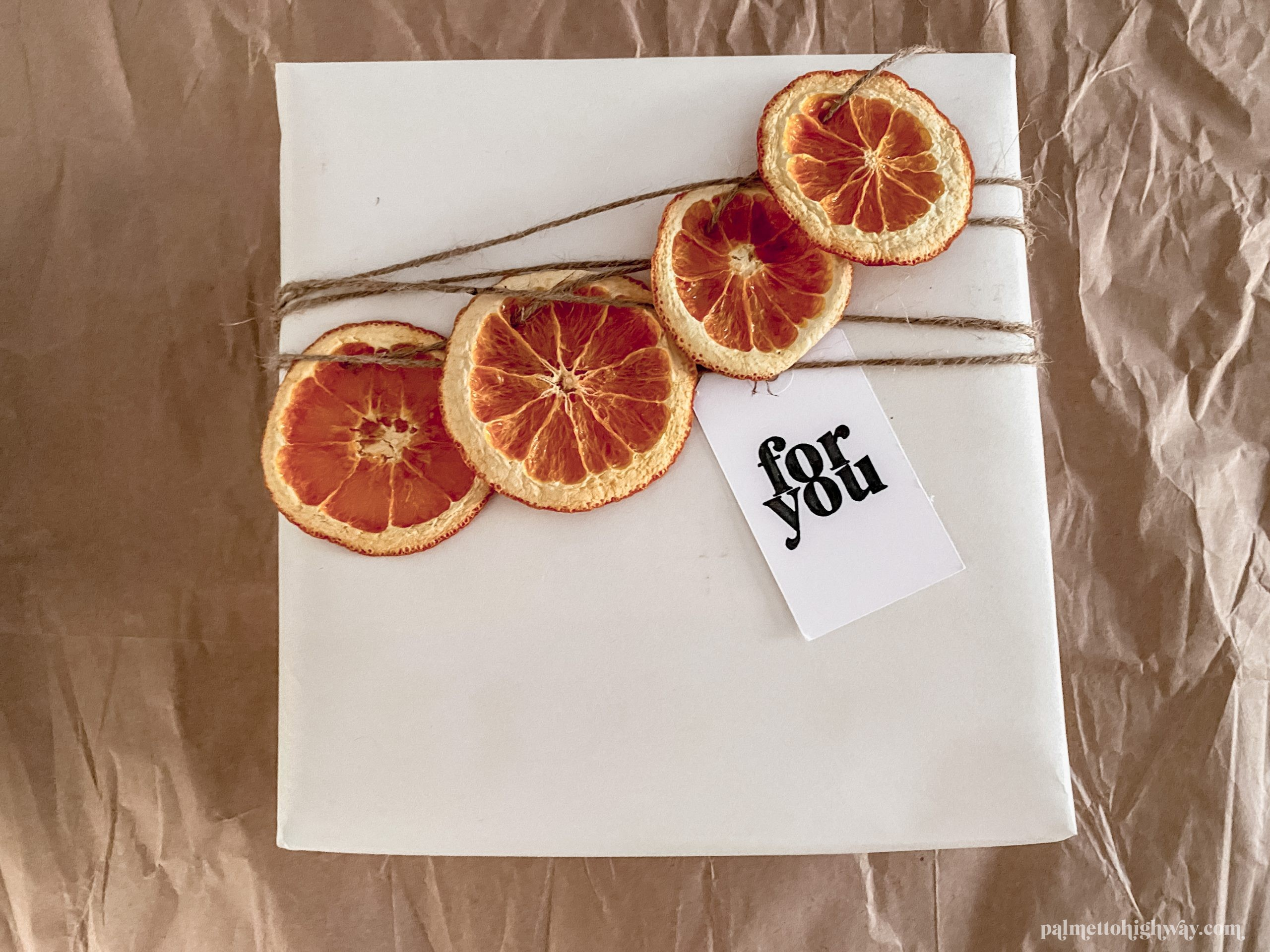 Gift wrapping example with an orange garland