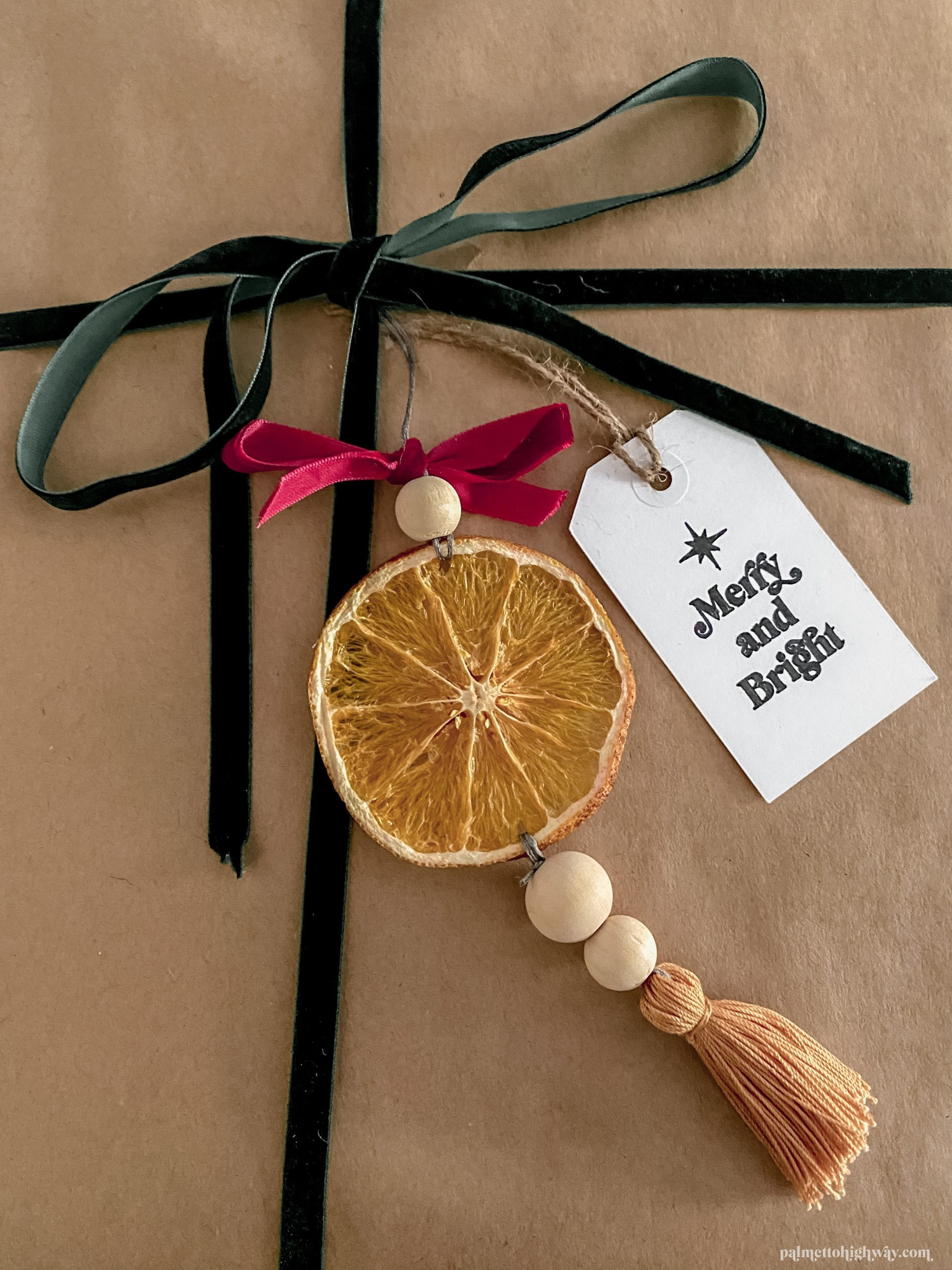 Gift wrapping example with dried orange gift topper